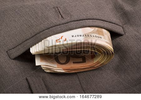 banknotes in the pocket of gray trousers
