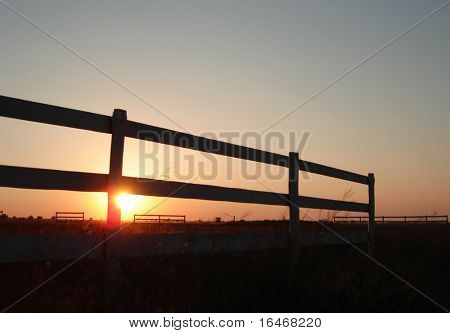 sunset on a horse stable