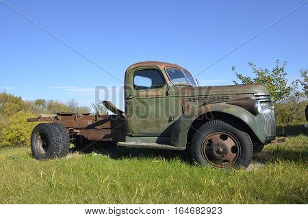 EAST GRAND FORKS: OCTOBER 1, 2016: The  V8 Ford truck missing it's box is a product of the Ford Motor Company located in Dearborn, Michigan started by Henry Ford and incorporated on June 16, 1903.