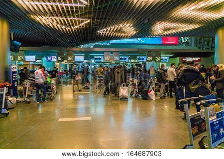 Moscow, Russia - December 25, 2016:  Passengers Stand At The Front Desk In Airport Vnukovo