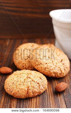 Almond cookie on a brown wooden background