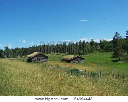Sod roofed little cabins on the ranch lands