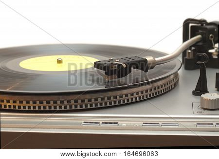 Turntable with vinyl record with yellow label isolated on white front view closeup
