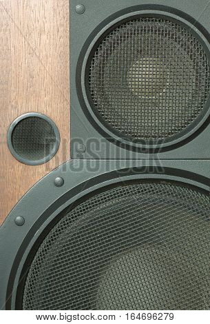 Loud speaker system with metal black grills front view closeup