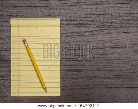 Dark Wood Desk Yellow Pad Pencil on Pad
