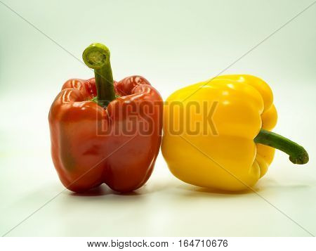 Red and Yellow paprika on white background sweet pepper bell pepper