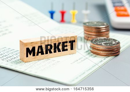 Text message Market on wooden with book bank, stacked coins. Finance concept