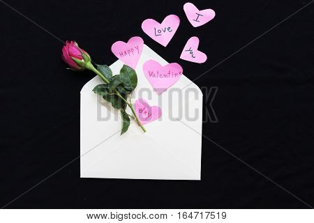 happy valentine day i love you words message on heart out and rose out of envelope on background black