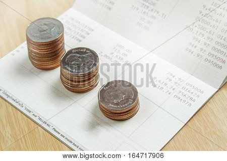 Bank book and money coins isolated on white background, business concept