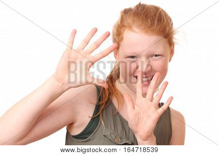 Portrait of a teenage girl showing stop gesture with hands on white background