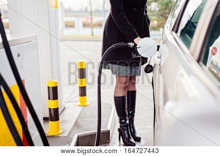 Woman Refueling Car With Diesel