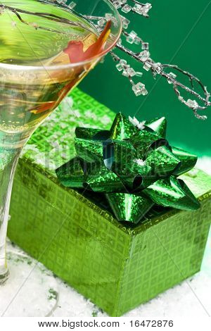 glass with champagne and gift box