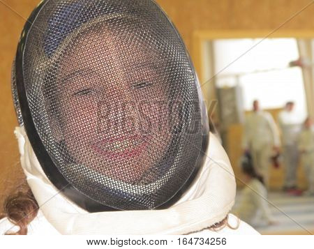 A Girl Who Smiles With Her Fencing Helmet
