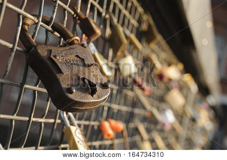 Love locks on a bridge railing in Tampere Finland Europe