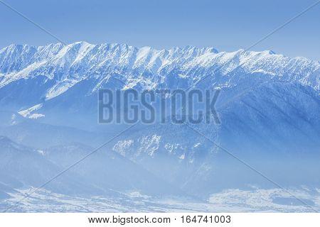 Winter Landscape Over The Piatra Craiului Mountains In Brasov Co