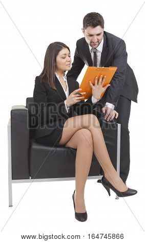 A young businesswoman and businessman are making a meeting