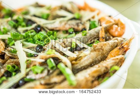 Fish fried in oil mixed with spices Chinese food