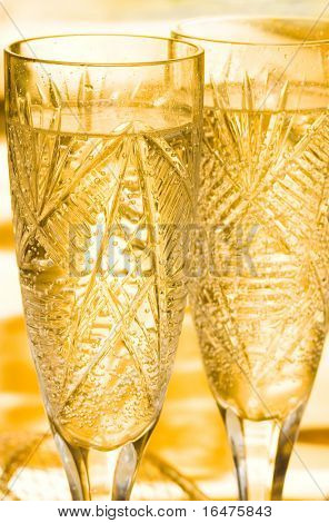 champagne in glass on yellow background