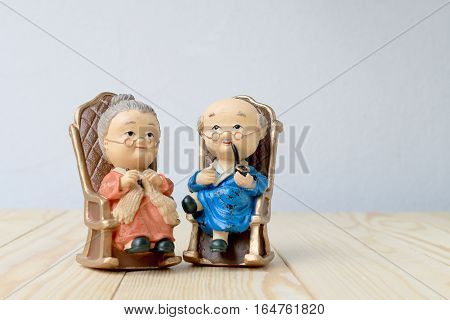 Lovely Grandparent Doll Siting Old Sofa Classic Chair Together On Wooden Table With Background.