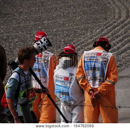 ISTANBUL/TURKEY-MAY 8, 2011 : Photographer of Formula-1 DHL Turkish Grand Prix race and spectacle in Istanbul Park Circuit with intervention marshal and fire marshal.