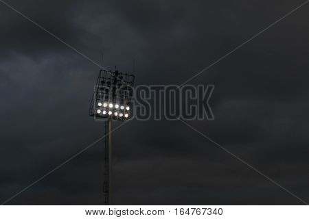 Light stadium or Sports lighting against raincloud