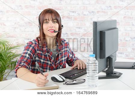 cheerful beautiful young support phone operator with headset