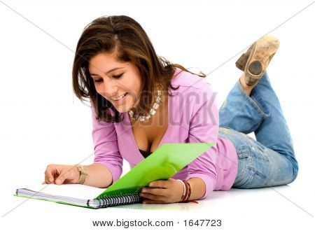 Female Student Reading A Notebook
