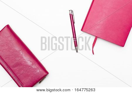 pink diary pen and wallet womens pink on a white background. business minimal concept for women. Flat lay top view