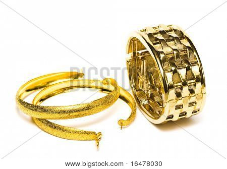 golden bracelet with ear-rings isolated on white background