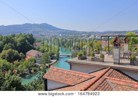 The picture was taken in the Swiss city Bern. The picture shows a view of the River Aare from the terrace located on the roof of a house.