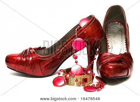 red shoes and decorations isolated on white background