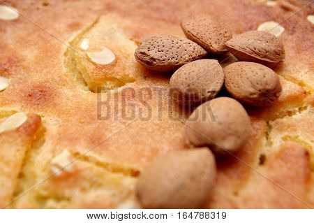 Unshelled Almond Nuts On A Freshly Backed Frangipane Tart Or Cake
