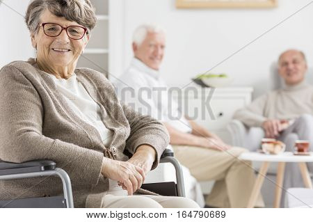 Smiled Woman On A Wheelchair
