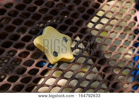 closeup Steel grating with a yellow star