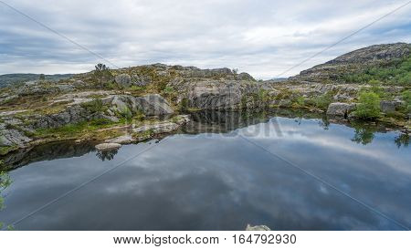 Forsand, Norway - May 28, 2016: Lake on the Preikestolen (Pulpit Rock) hike trail