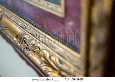 Old gilded frame. Antique frame with ornament. Recognize the art.