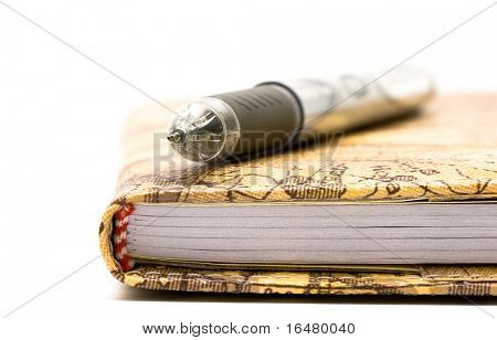 black pen with notebook isolated on white background