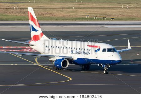 DUSSELDORF GERMANY - DEC 16 2016: British Airways CityFlyer Embraer ERJ-170STD arriving at Dusseldorf airport.