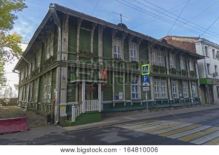 MOSCOW RUSSIA - OCTOBER 2 2016: Old two-storey wooden house in the center of Moscow. Per. Ogorodnaya Sloboda 9.