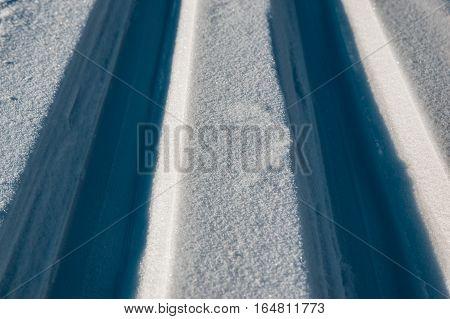 Closeup background photo of tracks of skis