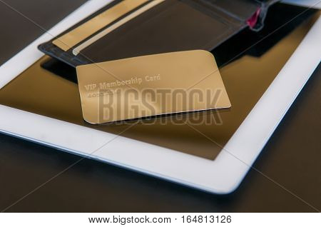 golden vip card on pad plus wallet