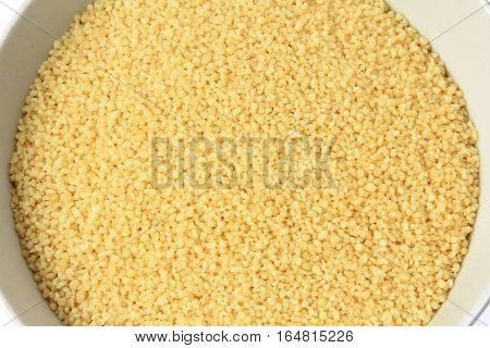 Instant Couscous in a white bowl in the kitchen