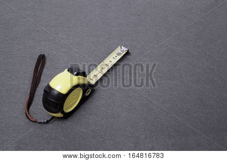 Measure tape, tool isolated on a gray background