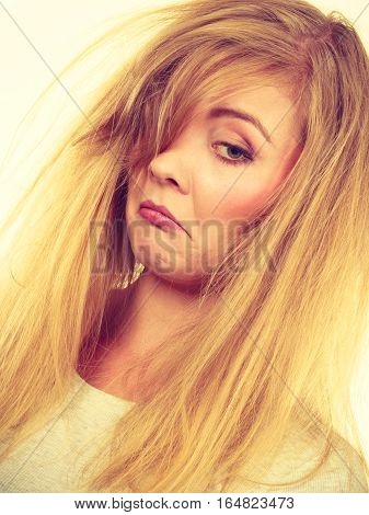 Sad Blonde Woman With Messy Hair