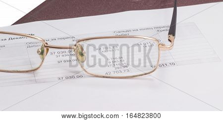 glasses lie on the document glass can be seen through the number amount