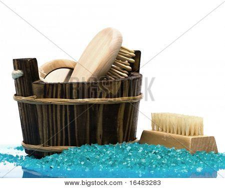 washtub with bath salt, comb, mirror and brush