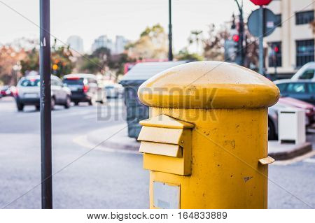 Big yellow mailbox for letters on the street