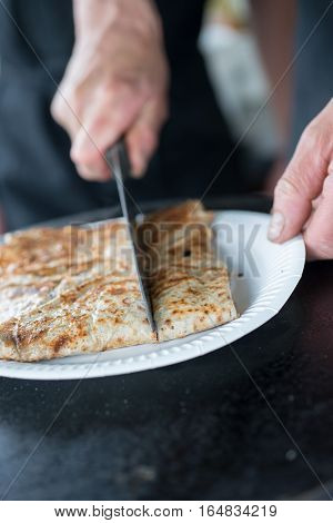 Crepe Being Sliced To Serving Size With A Knife