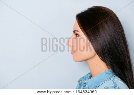 Side View Of Young Confident Woman Isolated On Gray Background