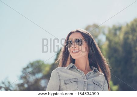 Portrait Of Cheerful Beautiful Woman In Spectacles On The Background Of Sky
